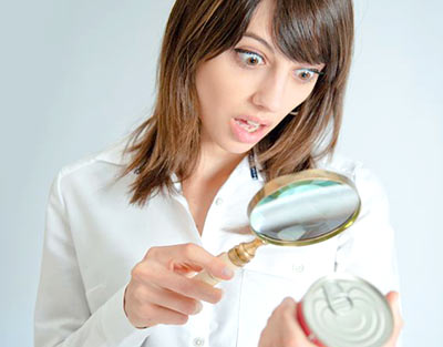 Woman-with-magnifier-aghast-crop
